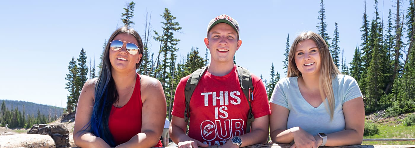 Three SUU students in the nearby mountains