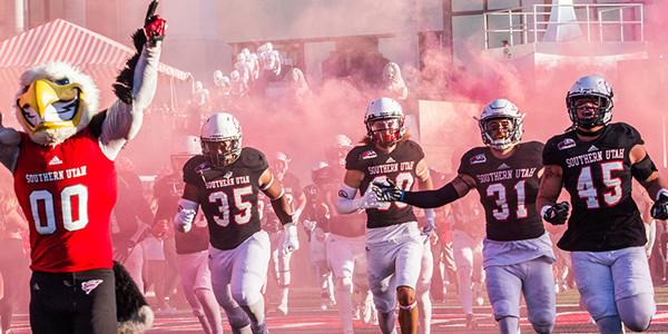 SUU's football team running onto the field