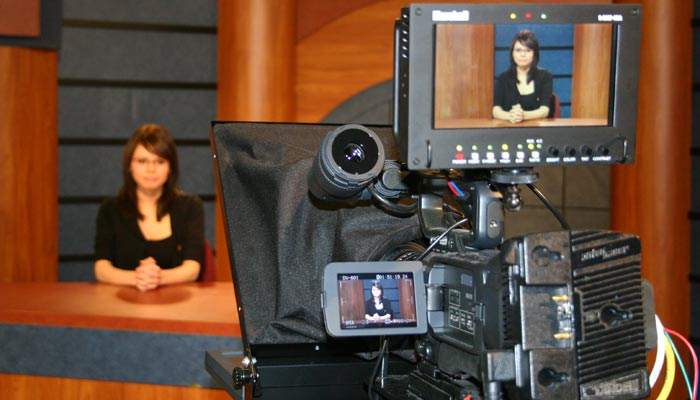Photo of student preparing for a newscast at SUTV.